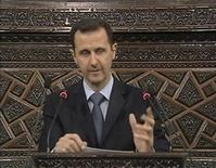 <p>Syrian President Bashar Al-Assad addresses the parliament in Damascus in this still image taken from a video footage March 30, 2011. REUTERS/Syrian state TV via Reuters TV</p>