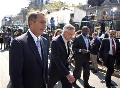 Speaker of the House John Boehner (R) (R-OH) and Senate Majority Leader Harry Reid (D-NV) walk together after speaking about the continuing budget negotiations, after meeting with President Barack Obama at the White House in Washington April 7, 2011. REUTERS/Joshua Roberts