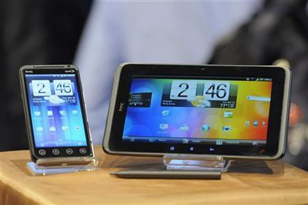 The HTC Evo 3D phone (L) and the HTC Evo View 4G tablet are unveiled by Sprint at the International CTIA wireless industry conference, at the Orange County Convention Center in Orlando, Florida March 22, 2011. REUTERS/Scott A. Miller