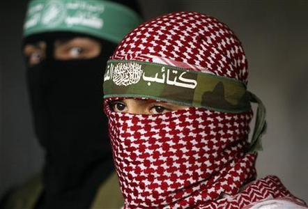 Palestinian Hamas militants attend a news conference in Gaza City April 9, 2011. REUTERS/Mohammed Salem