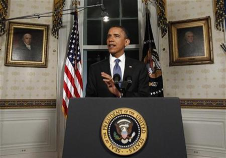 U.S. President Barack Obama re-reads his statement from the Blue Room about the budget at the White House in Washington April 8, 2011. REUTERS/Jim Young