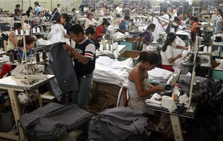 People work in a maquiladora, or garment assembly plant, in Tehuacan, Mexico, in a file photo. REUTERS/Jennifer Szymaszek