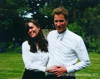 <p>Kate Middleton and Prince William on their graduation day at St Andrews University,June 23, 2005. REUTERS/The Middleton Family, 2011</p>