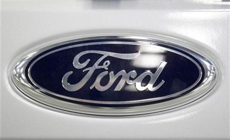 The logo of Ford car manufacturer is seen on a Focus car at the Ford car plant in Saarlouis, August 26, 2010. REUTERS/Vincent Kessler