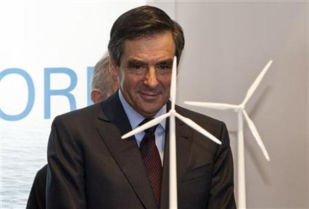 France's Prime Minister Francois Fillon watches models of power-generating windmill turbines at the stand of NORDEX during their opening tour at the ''Hannover Messe'' industrial trade fair in Hanover April 4, 2011. REUTERS/Morris Mac Matzen