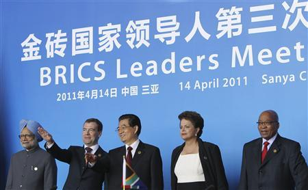 (L-R) India's Prime Minister Manmohan Singh, Russia's President Dmitry Medvedev, China's President Hu Jintao, Brazil's President Dilma Rousseff and South African President Jacob Zuma attend a joint news conference at the BRICS Leaders Meeting in Sanya, Hainan province April 14, 2011. The development banks of the five BRICS nations agreed in principle on Thursday to establish mutual credit lines denominated in their local currencies, not in dollars. REUTERS/How Hwee Young/Pool