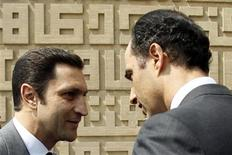 <p>Egyptian President Hosni Mubarak's sons Alaa Mubarak (L) and Gamal Mubarak, who is also the head of the higher political committee of the National Democratic Party (NDP), visit late former President Anwar al-Sadat's tomb in Cairo during his 29th death anniversary October 6, 2010. REUTERS/Amr Abdallah Dalsh</p>