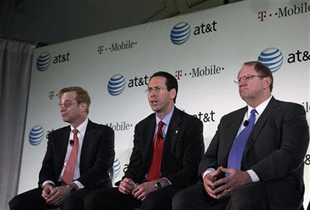 AT&T Inc. CEO Randall Stephenson, (C) joined by Jim Cicconi, senior executive vice president-external and legislative affairs for AT&T and Wayne Watts, (R) Senior Executive Vice President and ATT&T General Counsel, speaks at a news conference to announce the company's proposal to buy T-Mobile USA from Deutsche Telekom in New York, March 21, 2011. REUTERS/Brendan McDermid