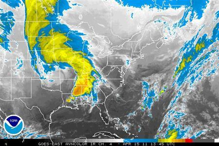 Storm systems are seen over the U.S. in an infrared satellite image taken April 15, 2011. REUTERS/NOAA/Handout