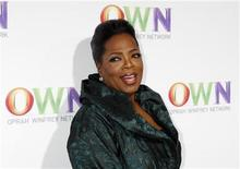 <p>Talk show host Oprah Winfrey poses at the OWN: Oprah Winfrey Network launch cocktail reception for the Television Critics Association winter press tour in Pasadena, California January 6, 2011. REUTERS/Fred Prouser</p>