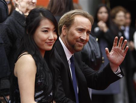Actor Nicolas Cage and his wife Alice Kim attend the hand and footprints ceremony for producer Jerry Bruckheimer at the Grauman's Chinese theatre in Hollywood, California in this May 17, 2010 file picture. REUTERS/Mario Anzuoni/Files