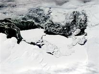 <p>The Mertz Glacier Tongue (centre, L) breaks away from the Mertz Glacier in this handout image acquired by the NASA's Aqua - MODIS satellite on February 26, 2010. REUTERS/NASA/Handout</p>