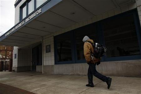 A man walks past the Youngstown Business Incubator in Youngstown, Ohio April 9, 2011. REUTERS/Eric Thayer