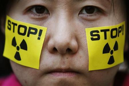 An anti-nuclear protester takes part in a rally in front of Tokyo Electric Power Co (TEPCO)'s headquarters in Tokyo April 15, 2011. REUTERS/Yuriko Nakao