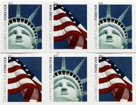 New USA First Class postage stamps, bearing an image of the Statue of Liberty and U.S. flags, are shown in Washington, April 15, 2011. The image is actually a photo of a half-sized replica of the statue that was created for and stands outside the New York-New York Hotel & Casino in Las Vegas. REUTERS/Hyungwon Kang