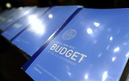 Staff members stack copies of U.S. President Barack Obama's proposed 2012 federal budget on Capitol Hill in Washington, February 14, 2011. REUTERS/Jonathan Ernst