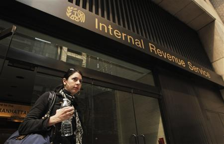 A woman walks out of an Internal Revenue Service office in New York April 18, 2011.The Internal Revenue Service had announced that taxpayers have until April 18, 2011 to file their 2010 returns and pay their tax bills because of a holiday on April 15. REUTERS/Lucas Jackson