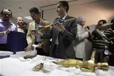 <p>Assistants at the Ministry of State for Antiquities, show the four objects that have been missing from the Egyptian museum since the January revolution and now returned, at the Supreme Council of Antiquities office in Cairo , April 12, 2011. REUTERS/Asmaa Waguih</p>