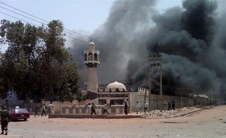 A mosque is set on fire by protesters after the release of the presidential elections results in Kano, northern Nigeria, April 18, 2011. REUTERS/Afolabi Sotunde