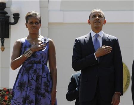 U.S. President Barack Obama and first lady Michelle Obama listen to their national anthem during an arrival ceremony at the National Palace in San Salvador March 22, 2011. REUTERS/Jason Reed