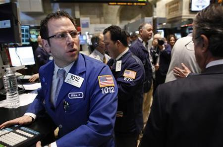 Trader Michael Pistillo calls out a price on the floor of the New York Stock Exchange, April 8, 2011. REUTERS/Brendan McDermid