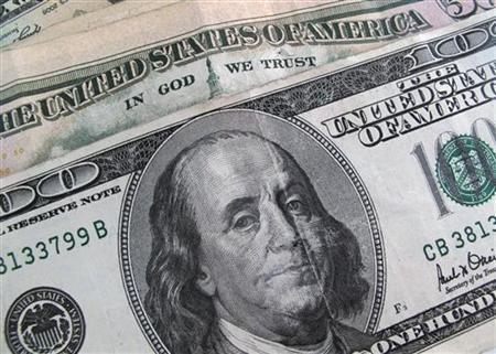 A U.S. $100 dollar bill is seen December 17, 2009. REUTERS/Sam Mircovich