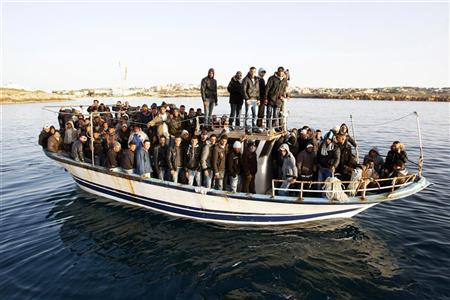 Migrants from North Africa arrive in the southern Italian island of Lampedusa March 7, 2011. REUTERS/Antonio Parrinello