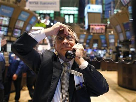 Floor trader Joe Quaglieri uses a phone on the floor of the New York Stock Exchange, April 18, 2011. REUTERS/Brendan McDermid