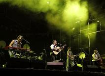 <p>English folk rock band Mumford and Sons' Marcus Mumford (2nd L), Winston Marshall (2nd R), Ted Dwane (R) and Ben Lovett (L) perform on the main stage during the second day of the Coachella Valley Music & Arts Festival in Indio, California April 16, 2011. REUTERS/Mike Blake</p>