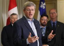 <p>Prime Minister and Conservative leader Stephen Harper speaks to the elderly during a campaign stop at St-Louis Residence in Riviere-du-Loup, April 20, 2011. REUTERS/Mathieu Belanger</p>