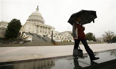 A worker departs the U.S. Capitol, April 8, 2011. REUTERS/Kevin Lamarque