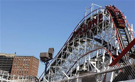 People ride the Cyclone roller coaster at Coney Island in New York, April 1, 2010. REUTERS/Shannon Stapleton