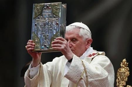 Pope Benedict XVI holds the book of the gospels as he leads the Chrismal mass in Saint Peter's basilica at the Vatican April 21, 2011. REUTERS/Stefano Rellandini