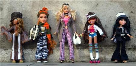 Bratz dolls and a Barbie Doll (C) are seen at the Dream Toys 2004 exhibition in London in this October 6, 2004 file photo. REUTERS/Stephen Hird/Files