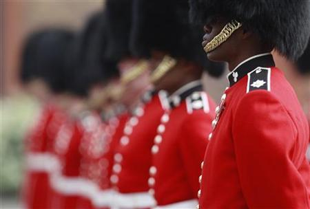 Irish Guards prepare for an inspection at their barracks in Windsor, southern England April 21, 2011. The Guards will perform ceremonial duties at the wedding of Britain's Prince William and Kate Middleton on April 29. REUTERS/Eddie Keogh