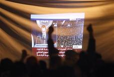 <p>Demonstrators gesture as they listen to Egyptian President Hosni Mubarak's televised speech screened in Tahrir Square in Cairo February 10, 2011. REUTERS/Asmaa Waguih</p>