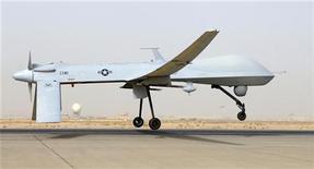 """<p>Беспилотный летательный аппарат MQ-1B Predator ВВС США на авиабазе """"Балад"""" в Ираке 12 июня 2008 года. Соединенные Штаты начали использовать беспилотные самолеты в Ливии, где не прекращается противостояние верных Муаммару Каддафи войск и повстанцев. REUTERS/U.S. Air Force photo by Senior Airman Julianne Showalter/Handout/Files</p>"""