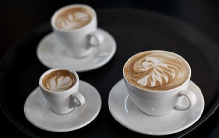 Latte art is displayed during the finals of the German Barista Championships in Hamburg April 17, 2011. REUTERS/Morris Mac Matzen