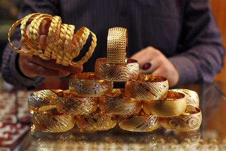 A goldsmith displays gold bangles in his jewellery shop in Istanbul April 22, 2011. REUTERS/Murad Sezer