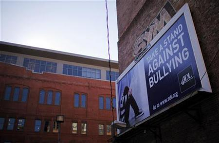 An anti-bullying billboard hangs on a building in downtown Boston, Massachusetts March 3, 2011. REUTERS/Brian Snyder