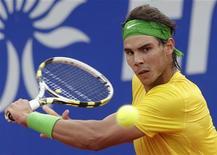 <p>Rafael Nadal, da Espanha, em jogo contra o croata Ivan Dodig durante a semi-final no Aberto de Barcelona, neste sábado. Nadal venceu por 6-3 e 6-2 e se classificou à final do torneio. 23/04/2011 REUTERS/Albert Gea</p>