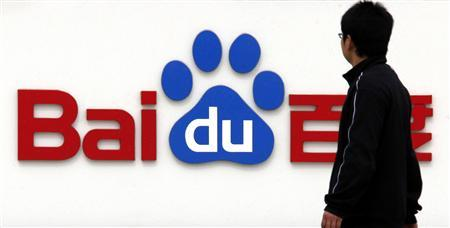 A pedestrian looks at the company logo of Baidu as he walks past their headquarters in Beijing in this March 24, 2010 file photo. China's Culture Ministry will punish Baidu Inc for providing illegal music downloads, Xinhua, China's official news agency reported on April 25, 2011. REUTERS/David Gray/Files