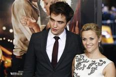 "<p>Actor Robert Pattinson arrives with Reese Witherspoon for the premiere of the film ""Water for Elephants"" in New York April 17, 2011. REUTERS/Lucas Jackson</p>"