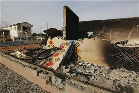 A burnt building is seen at the main city entrance, a day after election riots, in the Kaduna metropolis in northern Nigeria April 19, 2011. REUTERS/Afolabi Sotunde