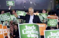 <p>NDP Leader Jack Layton waves to supporters during a campaign stop in downtown Montreal April 23, 2011. REUTERS/Christinne Muschi</p>