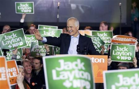 NDP Leader Jack Layton waves to supporters during a campaign stop in downtown Montreal April 23, 2011. REUTERS/Christinne Muschi
