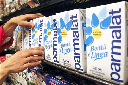 A worker checks cartons of milk in a supermarket in Rome in this April 1, 2011 file photograph. French dairy group Lactalis launched a 3.375 billion euro ($4.9 billion) takeover bid for Italian rival Parmalat, raising pressure on Italian investors who want to keep the company in domestic hands. Lactalis, Europe's biggest dairy group, bought 29 percent of Parmalat in March, sparking alarm in Rome that one of Italy's best-known companies could fall under foreign control. REUTERS/Max Rossi/Files