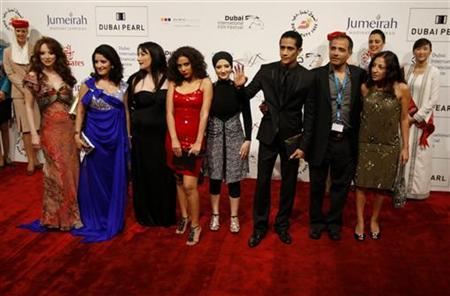 Egyptian director of ''Cairo Exit'' Hesham Issawi (2nd R) poses with cast members on the red carpet during the closing ceremony of the 7th Dubai International Film Festival December 19, 2010. REUTERS/Jumana El Heloueh