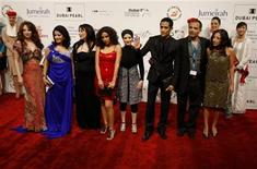 "<p>Egyptian director of ""Cairo Exit"" Hesham Issawi (2nd R) poses with cast members on the red carpet during the closing ceremony of the 7th Dubai International Film Festival December 19, 2010. REUTERS/Jumana El Heloueh</p>"