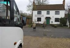 <p>Visitors leave The Old Boot Inn to board their bus during a whistlestop tour of the Berkshire childhood haunts of Kate Middleton, fiancee of Britain's Prince William, in Bucklebury February 20, 2011. REUTERS/Kieran Doherty</p>